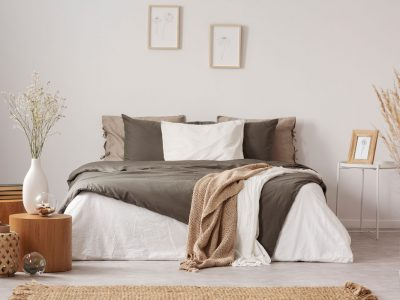 Spacious bedroom interior in beige and olive colour