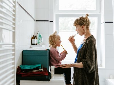 Photo series of a young mother with a child doing different chores at home. Shot in Berlin.